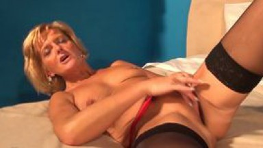 Blonde horny granny has orgasm on the table in kitchen