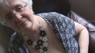 Granny with huge boobs teasing and stripping